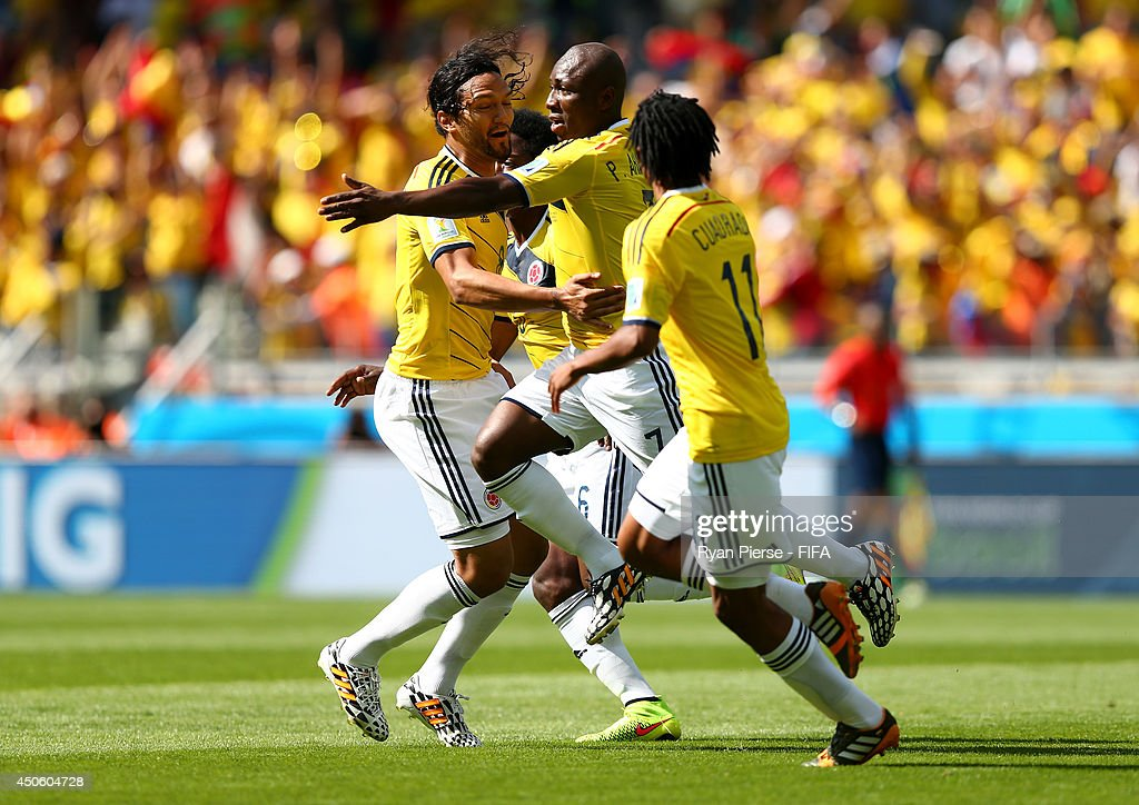 Pablo Armero of Colombia (C) celebrates after scoring the opening goal during the 2014 FIFA World Cup Brazil Group C match between Colombia and Greece at Estadio Mineirao on June 14, 2014 in Belo Horizonte, Brazil.