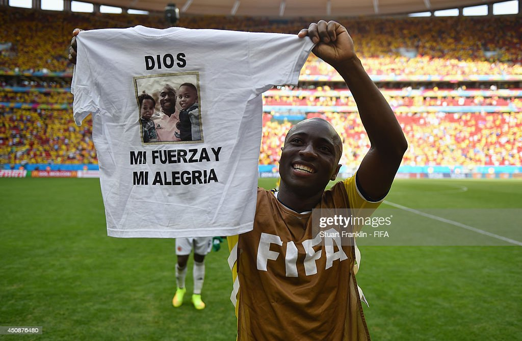 <a gi-track='captionPersonalityLinkClicked' href=/galleries/search?phrase=Pablo+Armero&family=editorial&specificpeople=631297 ng-click='$event.stopPropagation()'>Pablo Armero</a> of Colombia celebrates the 2-1 win after the 2014 FIFA World Cup Brazil Group C match between Colombia and Cote D'Ivoire at Estadio Nacional on June 19, 2014 in Brasilia, Brazil.