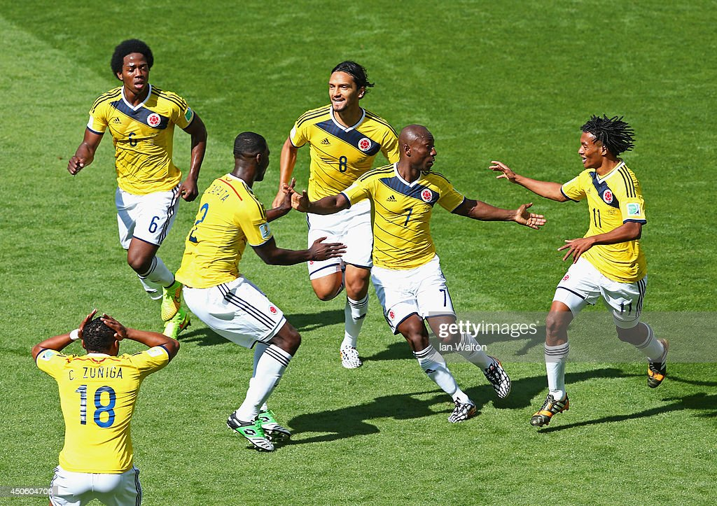 Pablo Armero of Colombia (2nd R) celebrates with teammates after scoring his team's first goal during the 2014 FIFA World Cup Brazil Group C match between Colombia and Greece at Estadio Mineirao on June 14, 2014 in Belo Horizonte, Brazil.
