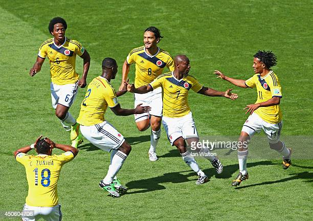 Pablo Armero of Colombia celebrates with teammates after scoring his team's first goal during the 2014 FIFA World Cup Brazil Group C match between...