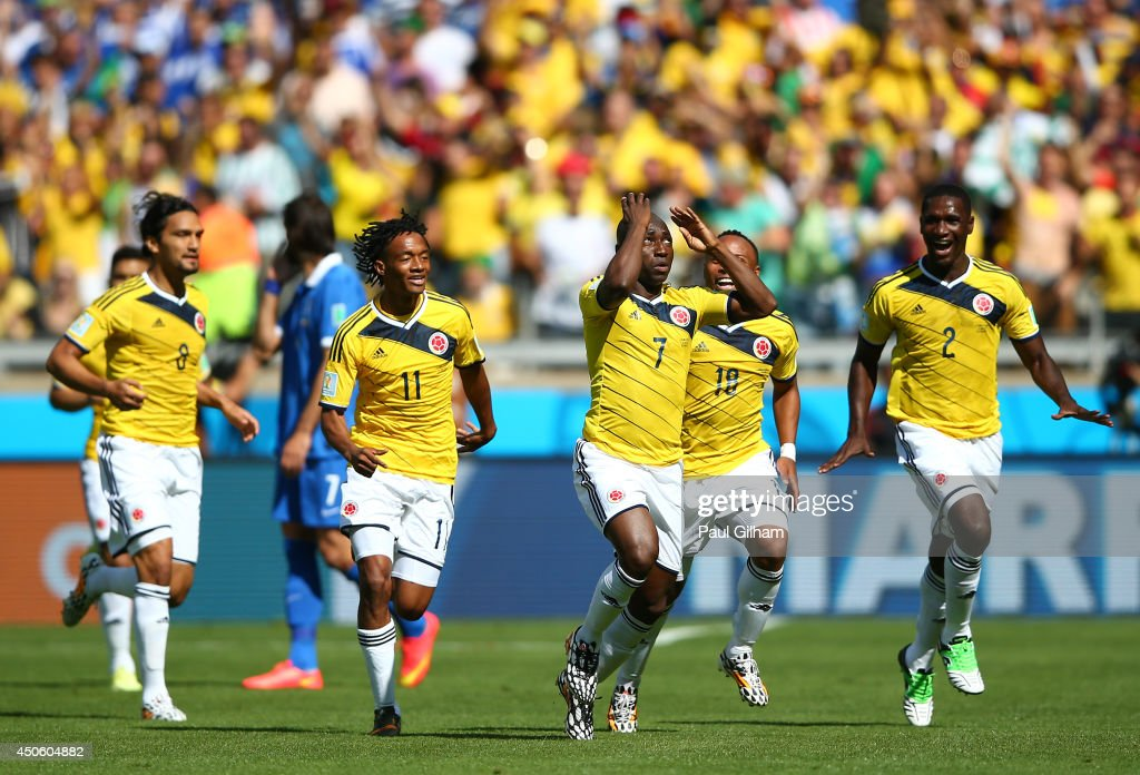 Pablo Armero of Colombia (C) celebrates with teammates after scoring his team's first goal during the 2014 FIFA World Cup Brazil Group C match between Colombia and Greece at Estadio Mineirao on June 14, 2014 in Belo Horizonte, Brazil.