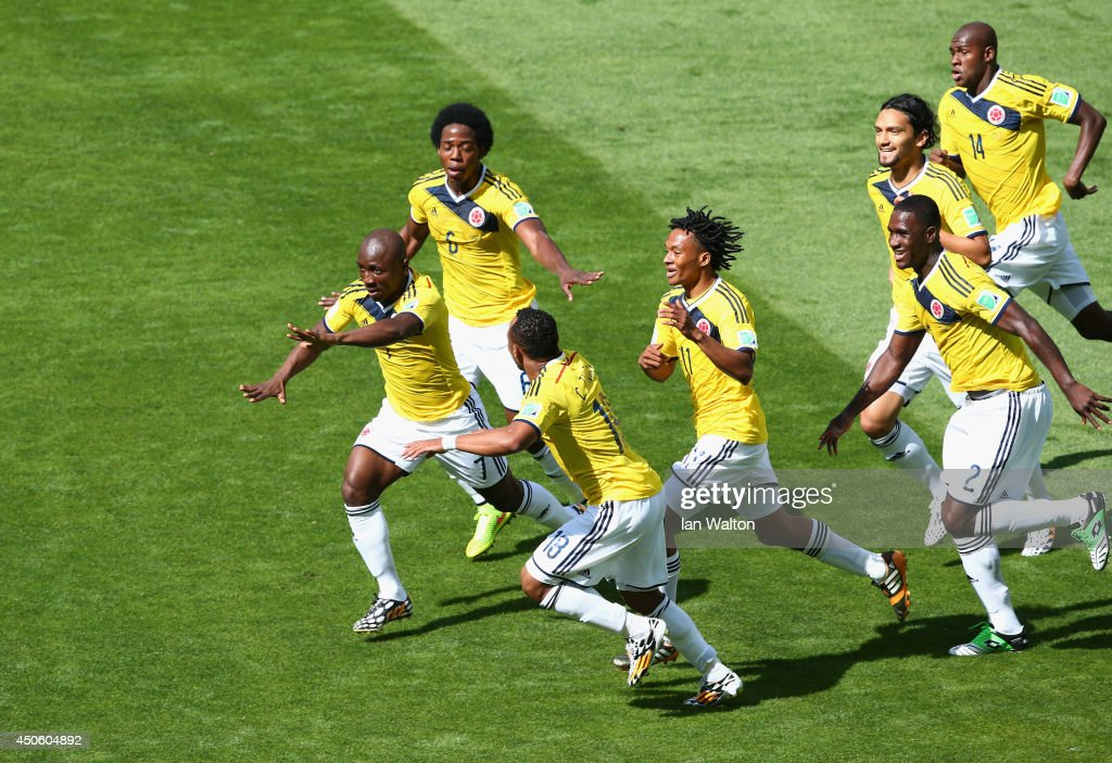 <a gi-track='captionPersonalityLinkClicked' href=/galleries/search?phrase=Pablo+Armero&family=editorial&specificpeople=631297 ng-click='$event.stopPropagation()'>Pablo Armero</a> of Colombia (L) celebrates with teammates after scoring his team's first goal during the 2014 FIFA World Cup Brazil Group C match between Colombia and Greece at Estadio Mineirao on June 14, 2014 in Belo Horizonte, Brazil.