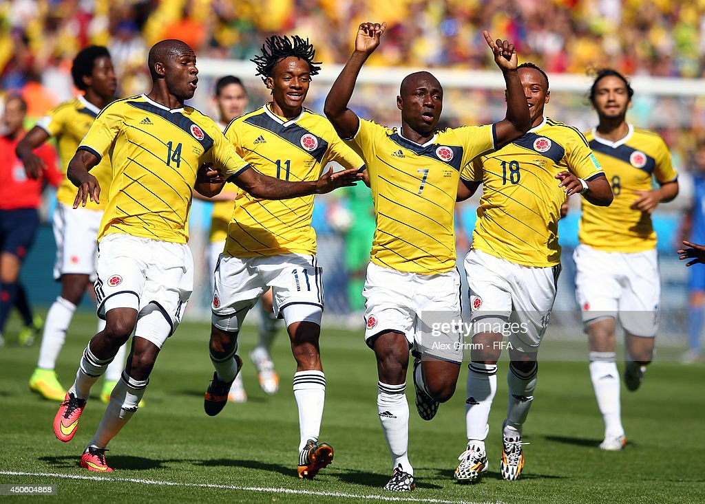 <a gi-track='captionPersonalityLinkClicked' href=/galleries/search?phrase=Pablo+Armero&family=editorial&specificpeople=631297 ng-click='$event.stopPropagation()'>Pablo Armero</a> of Colombia (C) celebrates with team-mates after scoring the opening goal during the 2014 FIFA World Cup Brazil Group C match between Colombia and Greece at Estadio Mineirao on June 14, 2014 in Belo Horizonte, Brazil.