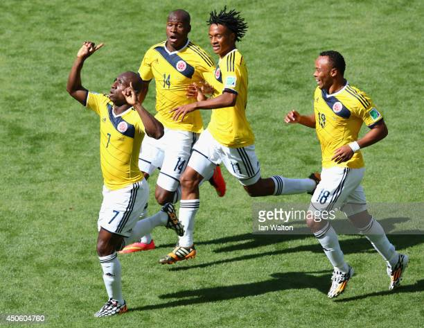 Pablo Armero of Colombia celebrates with teammates Victor Ibarbo Juan Guillermo Cuadrado and Juan Camilo Zuniga after scoring his team's first goal...