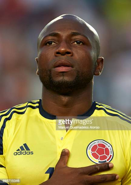 Pablo Armero of Colombia stands for their national athem prior to the international friendly match between Spain and Colombia at Nueva Condomina...