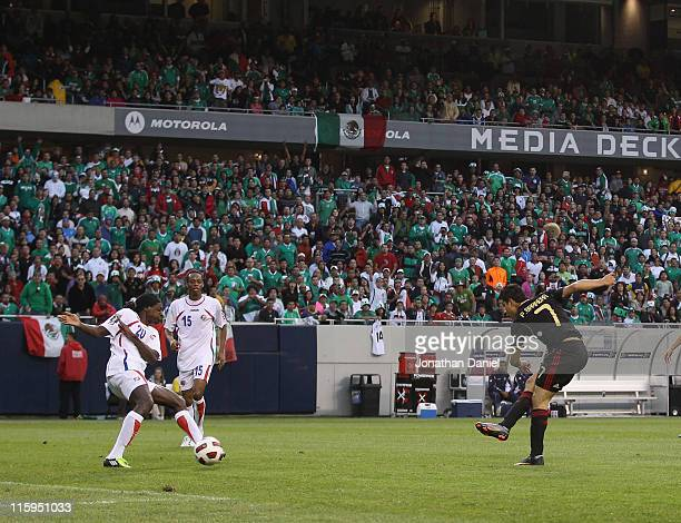 Pablo Barrera of Mexico fires a shot for a goal past Dennis Marshall of Costa Rica during a CONCACAF Gold Cup 2011 match at Soldier Field on June 12...