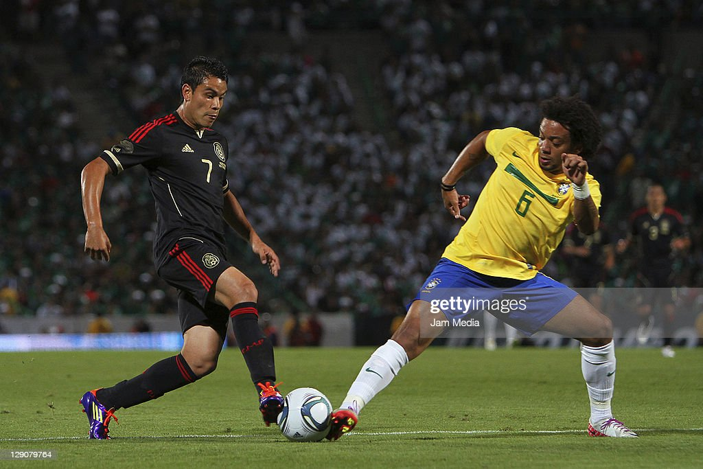 <a gi-track='captionPersonalityLinkClicked' href=/galleries/search?phrase=Pablo+Barrera&family=editorial&specificpeople=4388462 ng-click='$event.stopPropagation()'>Pablo Barrera</a> (L) of Mexico struggles for the ball with Marcelo Vieira (R) of Brasil during a friendly match between Mexico National Team and Brasil National Team at the Georgia Dome on October 11, 2011 in Torreon, Mexico.