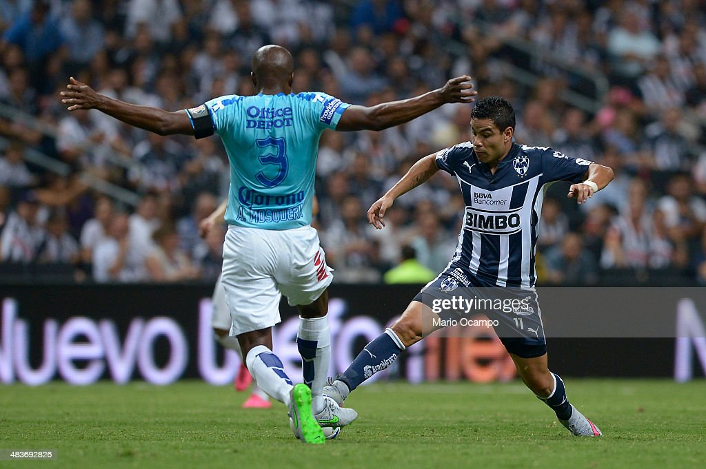 <a gi-track='captionPersonalityLinkClicked' href=/galleries/search?phrase=Pablo+Barrera&family=editorial&specificpeople=4388462 ng-click='$event.stopPropagation()'>Pablo Barrera</a> of Monterrey (R) fights for the ball with <a gi-track='captionPersonalityLinkClicked' href=/galleries/search?phrase=Aquivaldo+Mosquera&family=editorial&specificpeople=624234 ng-click='$event.stopPropagation()'>Aquivaldo Mosquera</a> of Pachuca (L) during a 4th round match between Monterrey and Pachuca as part of the Apertura 2015 Liga MX at BBVA Bancomer Stadium on August 11, 2015 in Monterrey, Mexico.