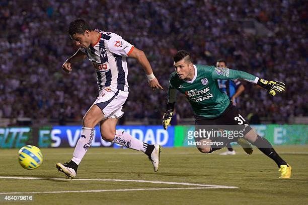 Pablo Barrera of Monterrey scores a goal over Tiago Volpi goalkeeper of Queretaro during a match between Monterrey and Queretaro as part of 7th round...