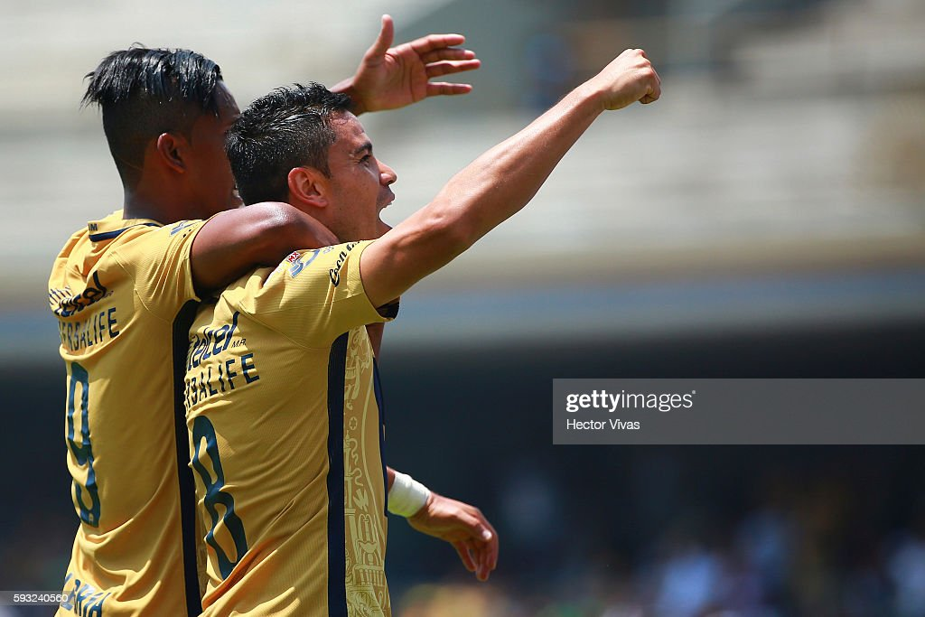 Pablo Barrera of Pumas celebrates with teammate Fidel Martinez after scoring the third goal of his team during the 6th round match between Pumas UNAM...
