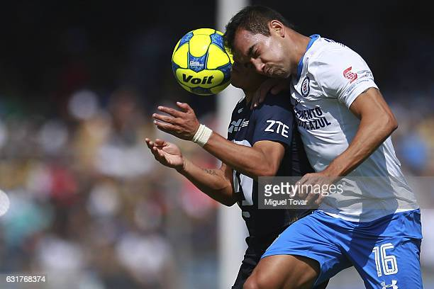Pablo Barrera of Pumas fights for the ball with Adrian Aldrete of Cruz Azul during the 2nd round match between Pumas UNAM and Cruz Azul as part of...