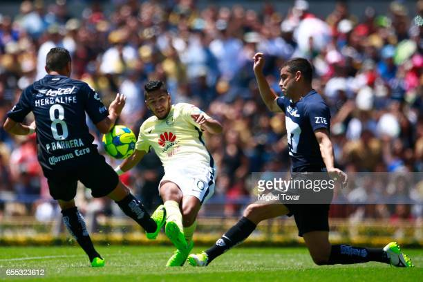 Pablo Barrera of Pumas fights for the ball with Cecilio Dominguez of America during the 11st round match between Pumas UNAM and America as par of the...