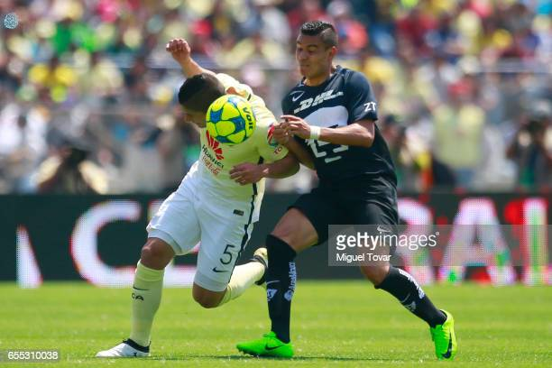 Pablo Barrera of Pumas fights for the ball with Javier Guemez of Club America during the 11st round match between Pumas UNAM and Club America as par...