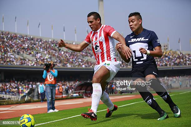 Pablo Barrera of Pumas fights for the ball with Mario de Luna of Necaxa during the 4th round match between Pumas UNAM and Necaxa as part of the...