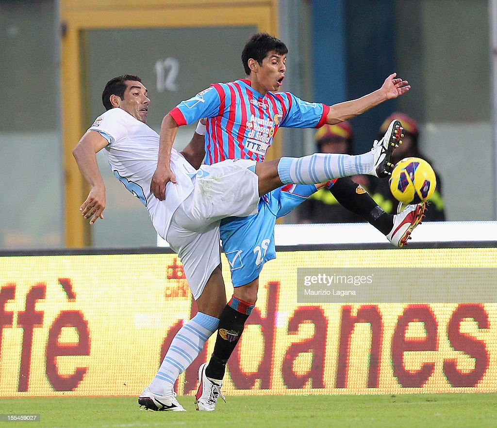 Pablo Barrientos (R) of Catania competes for the ball with Andre' Dias of Lazio during the Serie A match between Calcio Catania and S.S. Lazio at Stadio Angelo Massimino on November 4, 2012 in Catania, Italy.