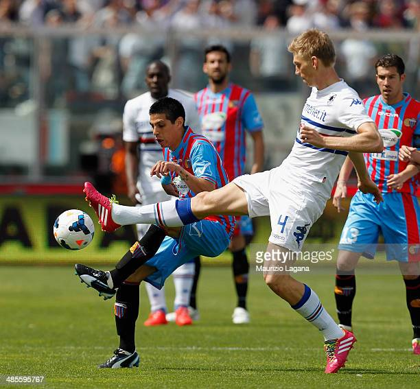 Pablo Barrientos of Catania competes for the ball with Bartosz Salamon of Sampdoria during the Serie A match between Calcio Catania and UC Sampdoria...
