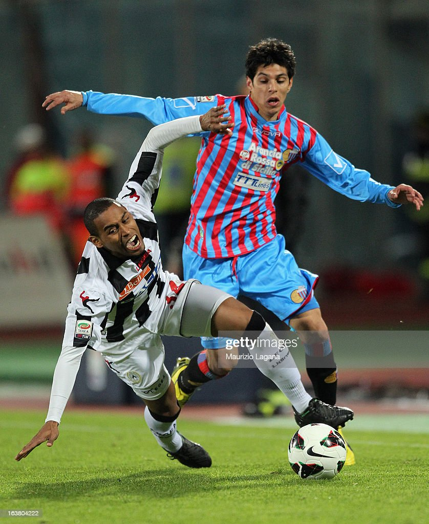 Pablo Barrientos of Catania competes for the ball with Gabriel Silva of Udinese during the Serie A match between Calcio Catania and Udinese Calcio at...
