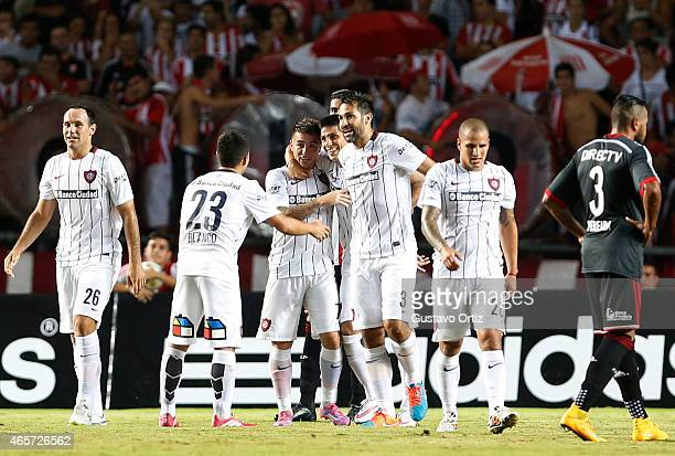 Pablo Barrientos of San Lorenzo celebrates with his teammates after scoring the second goal of his team during a match between Estudiantes and San...