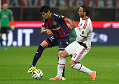 Pablo Barrientos of San Lorenzo competes for the ball with Giampaolo Pazzini of AC Milan during Luigi Berlusconi Trophy at Stadio Giuseppe Meazza on...