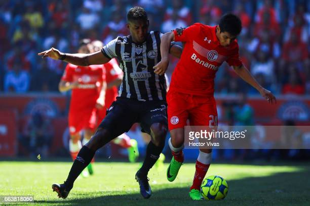 Pablo Barrientos of Toluca struggles for the ball with Brayan Beckles of Necaxa during the 12th round match between Toluca and Necaxa as part of the...