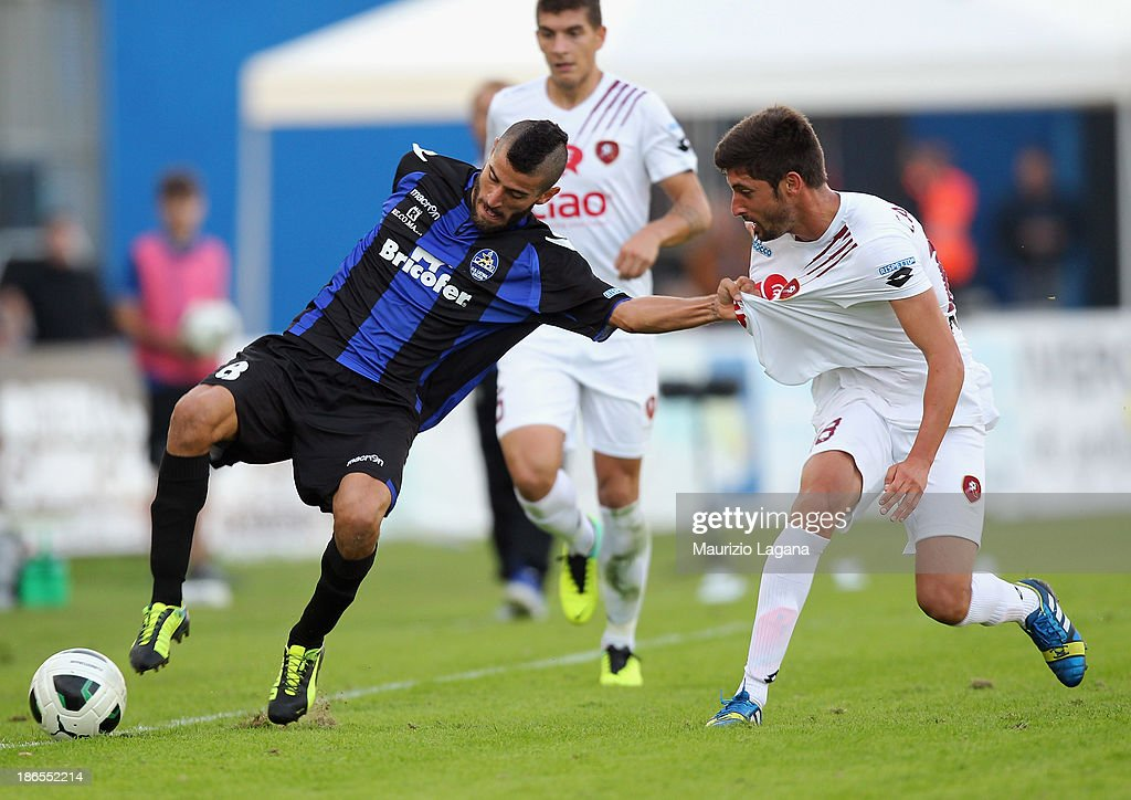 Pablo Caballero (R) of Reggina competes for the ball with Marco Crimi of Latina during the Serie B match between US Latina and Reggina Calcio at Stadio Domenico Francioni on November 1, 2013 in Latina, Italy.