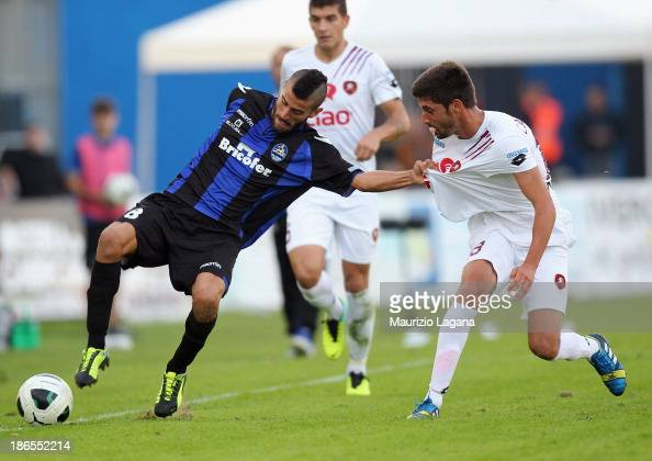 Pablo Caballero of Reggina competes for the ball with Marco Crimi of Latina during the Serie B match between US Latina and Reggina Calcio at Stadio...