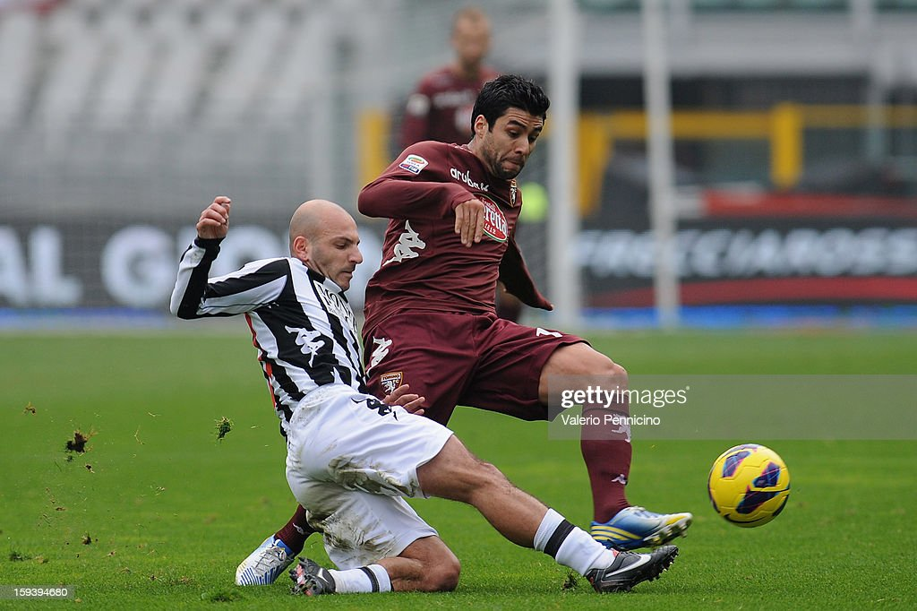 <a gi-track='captionPersonalityLinkClicked' href=/galleries/search?phrase=Pablo+Caceres&family=editorial&specificpeople=764828 ng-click='$event.stopPropagation()'>Pablo Caceres</a> (R) of Torino FC is challenged by Alessandro Rosina of AC Siena during the Serie A match between Torino FC and AC Siena at Stadio Olimpico di Torino on January 13, 2013 in Turin, Italy.