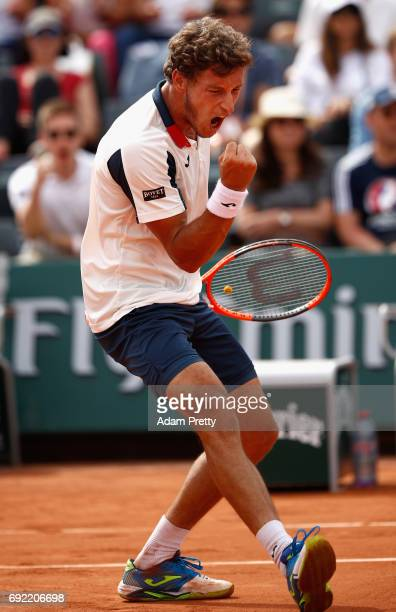 Pablo Carreno Busta of France celebrates victory in the mens singles fourth round match against Milos Raonic of Canada on day eight of the 2017...