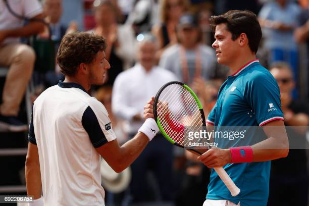 Pablo Carreno Busta of France is congratulated on victory by his opponant the mens singles fourth round match against Milos Raonic of Canada on day...