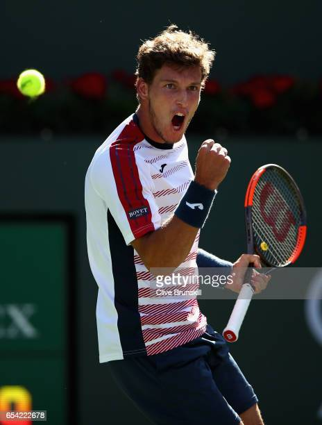 Pablo Carreno Busta of Spain celebrates a point against Pablo Cuevas of Uruguay in their quarter final match during day eleven of the BNP Paribas...