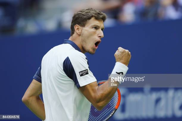 Pablo Carreno Busta of Spain celebrates a point in the first set against Kevin Anderson of South Africa during their Men's Singles Semifinal match on...