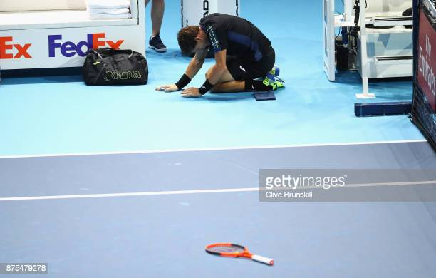 Pablo Carreno Busta of Spain drops to his knees in his Singles match against Grigor Dimitrov of Bulgaria during day six of the Nitto ATP World Tour...