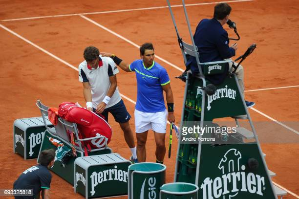 Pablo Carreno Busta of Spain gets injured and Rafael Nadal of Spain during the day 11 of the French Open at Roland Garros on June 7 2017 in Paris...