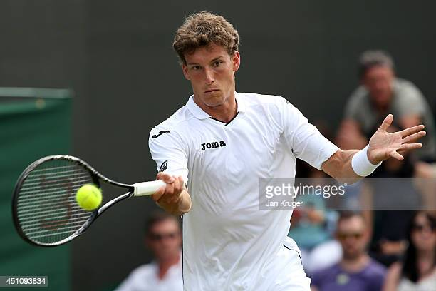 Pablo Carreno Busta of Spain in action during his Gentlemen's Singles first round match against David Ferrer of Spain on day one of the Wimbledon...