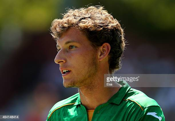 Pablo Carreno Busta of Spain looks on against Andreas Beck of Germany on Day One of the 2014 US Open at the USTA Billie Jean King National Tennis...