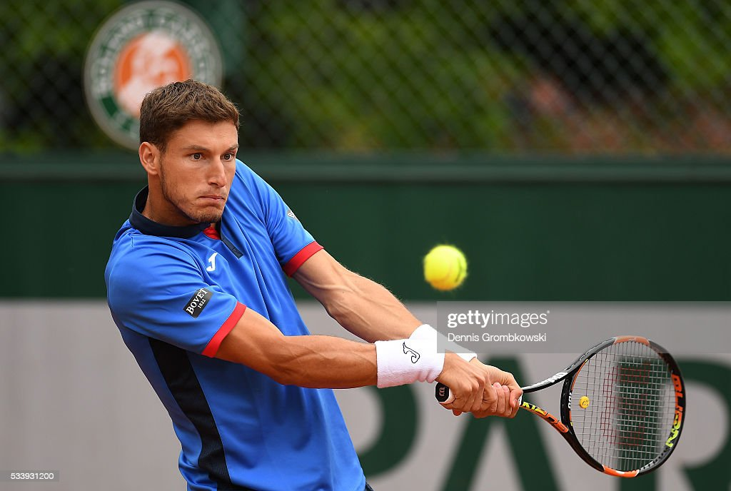 Pablo Carreno Busta of Spain plays a backhand during the Men's Singles first round match against Federico Delbonis of Argentina on day three of the 2016 French Open at Roland Garros on May 24, 2016 in Paris, France.