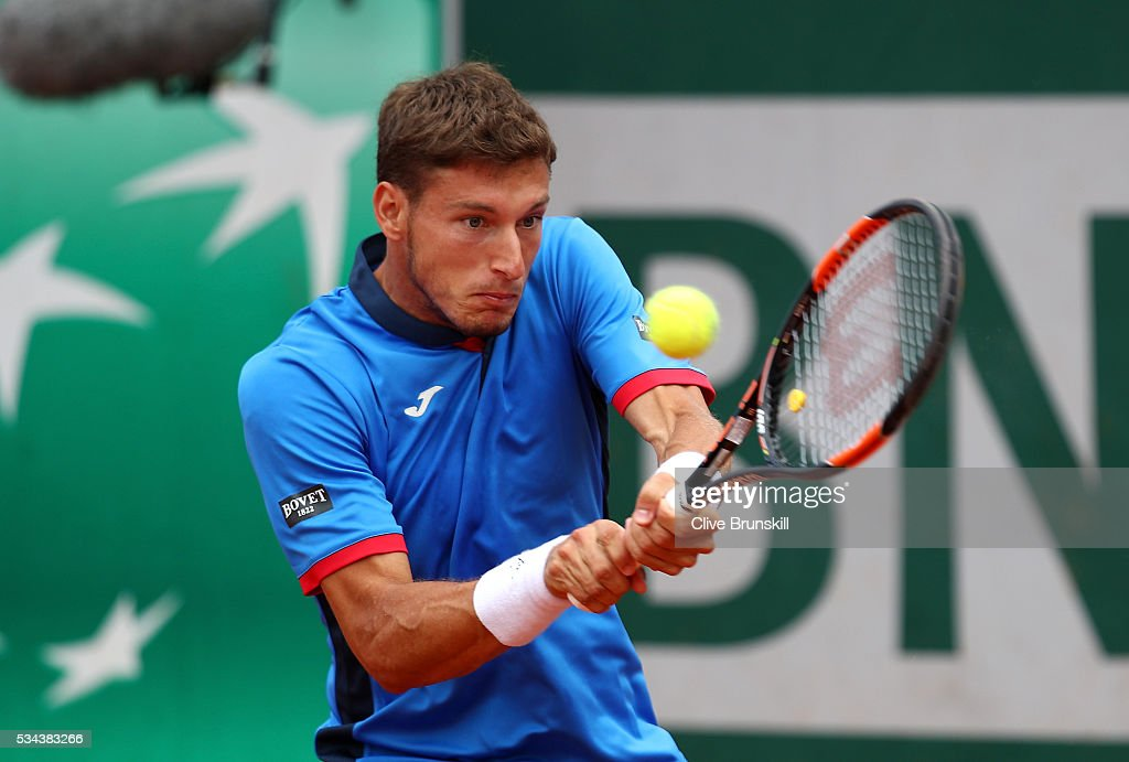 Pablo Carreno Busta of Spain plays a backhand during the Men's Singles second round match against Aljaz Bedene of Great Britain on day five of the 2016 French Open at Roland Garros on May 26, 2016 in Paris, France.