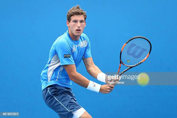 Pablo Carreno Busta of Spain plays a backhand in his first round match against Gilles Muller of Luxembourg during day two of the 2015 Australian Open...