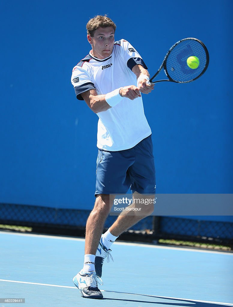 Pablo Carreno Busta of Spain plays a backhand in his first round match against Julien Benneteau of France during day one of the 2014 Australian Open at Melbourne Park on January 13, 2014 in Melbourne, Australia.