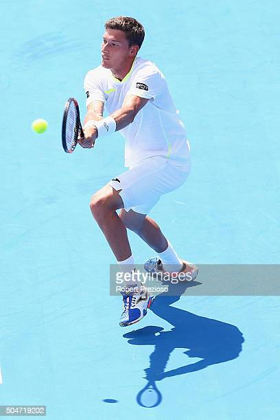 Pablo Carreno Busta of Spain plays a backhand in his match against Marcos Baghdatis of Cyprus during day two of the 2016 Kooyong Classic at Kooyong...