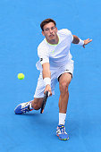 Pablo Carreno Busta of Spain plays a backhand in his match against Gilles Simon of France during day four of the 2016 Kooyong Classic at Kooyong on...