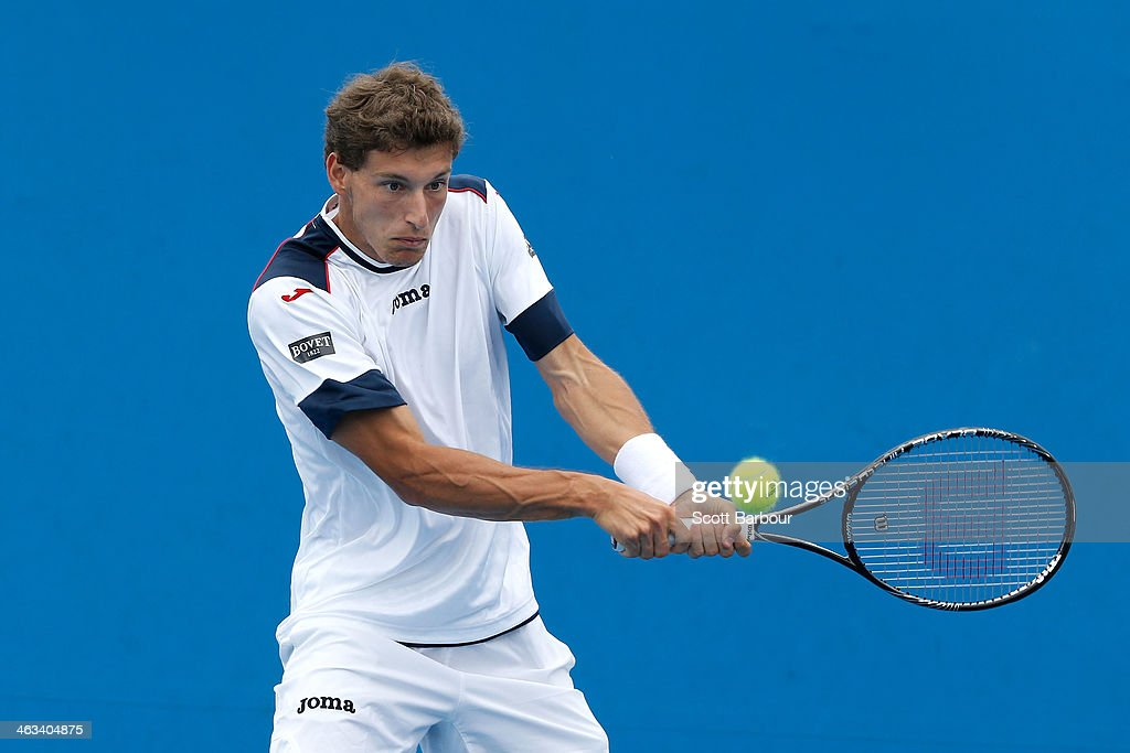Pablo Carreno Busta of Spain plays a backhand in his second round doubles match with Guillermo Garcia-Lopez of Spain against Oliver Marach of Austria and Florin Mergea of Romania during day six of the 2014 Australian Open at Melbourne Park on January 18, 2014 in Melbourne, Australia.
