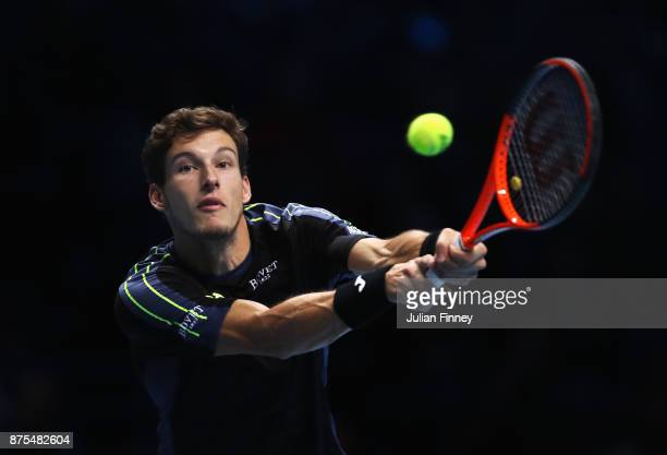 Pablo Carreno Busta of Spain plays a backhand in his Singles match against Grigor Dimitrov of Bulgaria during day six of the Nitto ATP World Tour...