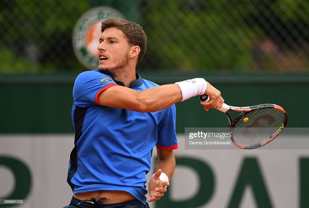 Pablo Carreno Busta of Spain plays a forehand during the Men's Singles first round match against Federico Delbonis of Argentina on day three of the 2016 French Open at Roland Garros on May 24, 2016 in Paris, France.
