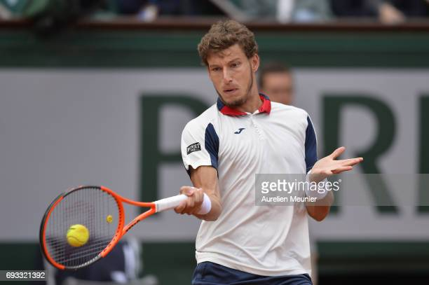 Pablo Carreno Busta of Spain plays a forehand during the men's singles quarterfinal match against Rafael Nadal of Spain on day eleven of the 2017...