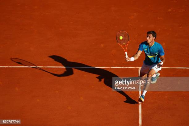 Pablo Carreno Busta of Spain plays a forehand volley against Novak Djokovic of Serbia in his third round match on day five of the Monte Carlo Rolex...