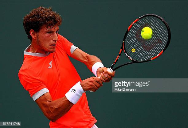 Pablo Carreno Busta of Spain plays a match against John Millman of Australia during Day 4 of the Miami Open presented by Itau at Crandon Park Tennis...