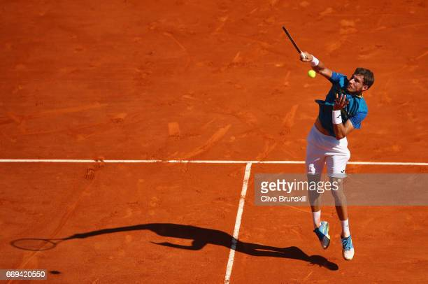 Pablo Carreno Busta of Spain plays a smash against Fabio Fognini of Italy in their first round match on day two of the Monte Carlo Rolex Masters at...