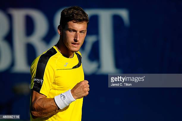 Pablo Carreno Busta of Spain reacts after a point in his match against PierreHugues Herbert of France during the fourth day of the WinstonSalem Open...