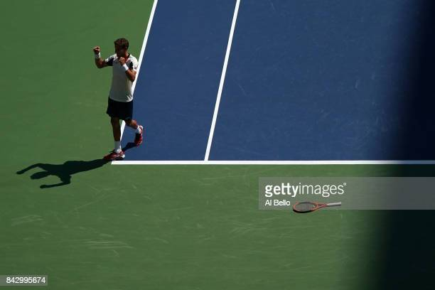 Pablo Carreno Busta of Spain reacts after defeating Diego Schwartzman of Argentina during his Men's Singles Quarterfinal match on Day Nine of the...